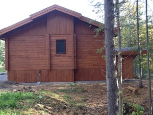 Rear view of cabin | Stained 6X8 tongue and groove white cedar lumber