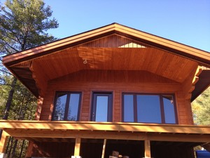 Front view of cabin | Over hang and deck all done in eastern white cedar