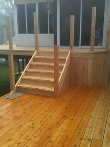 Deck under construction 2x6 white cedar lumber random lengths