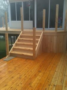 Deck under construction 2x6 white cedar lumber random lengths 4x4 square cedar posts for railing system
